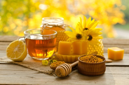 Still life from cup of tea , lemon, honey, wax , honeycombs and