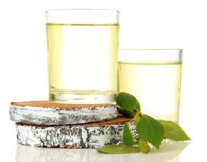Glasses of birch sap, isolated on white